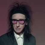 **NEW DATE THURSDAY 19 JULY 2018**Tickets in the front 3 rows - £23.50, all other seats - £20.50, students - £16 John Cooper Clarke shot to prominence in the 1970s as the original 'people's poet'. Since then his career has spanned cultures, audiences, art forms and continents. Today, JCC is as relevant and vibrant as ever, and his influence just as visible on today's pop culture. Aside from his trademark 'look' continuing to resonate with fashionistas young and old, and his poetry included on national curriculum syllabus, his effect on modern music is huge.  His influence can be heard within the keen social observations of the Arctic Monkeys and Plan B. These collaborations mean that John has been involved in 2 recent global number 1 albums - with The Arctic Monkeys putting one of John's best loved poems, I Wanna Be Yours, to music on their critically acclaimed A:M Album  This latest show is a mix of classic verse, extraordinary new material, hilarious ponderings on modern life, good honest gags, riffs and chat - a chance to witness a living legend at the top of this game. Running times:Clare Ferguson-Walker - 7:45pm - 8:15pmInterval - 8:15pm - 8:40pmJohn Cooper Clarke - 8:40pm - 9.50pm