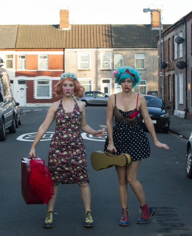 "Thursday 25 July at 7.45pmTickets - £13.25, concessions - £11.25  Flossy and Boo have been plonked right inthe middle of what is known as ""The Real World"", and have been told in no uncertain terms that they are in fact, 'Girls'. But what is a 'Girl'? And who gets to decide? In this cabaret-style theatre show, Flossy and Boo explore all the intricacies of what it means to be female in the modern world. From feminism to romance, to the wonder of Kate Bush, the audience decide what comes next in the show – leading to hilarious and unexpected results. Girl on Girl is filled with Music, Comedy, and Flossy and Boo's own curious take on the world around us and the ridiculous life cards we are dealt.  Think of the theatrical equivalent of putting your hand down the side of the sofa. Gross, a tiny layer of crumb, a smudge of gum, but then you find that forgotten tenner! (You know the one they allowed a lady's face on…)"